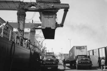 1962 - A gantry crane in operation in Sea-Land's terminal. The Port spent $300,000 to construct the terminal, inaugurating the container age on the West Coast. Courtesy of the Port of Long Beach