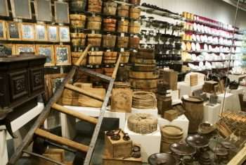 Dishes and Housewares Includes rope, tobacco, small animal traps, mirrors, stove, water buckets, dishware, candles, clay pipes, kettles, two-wheel dolly, and many more items.
