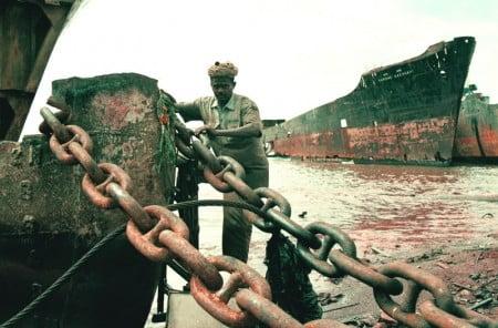 Workers scrapping ship at Alang scrap yard.